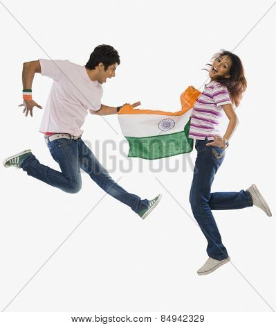 Couple holding Indian flag and jumping