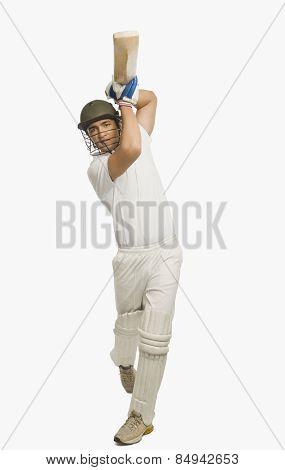 Cricket batsman playing a straight drive
