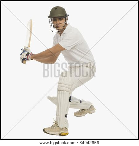 Cricket batsman playing a stroke