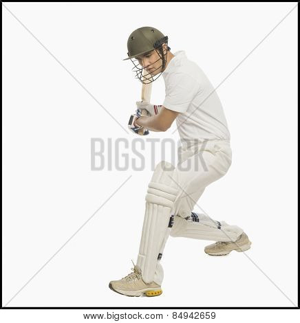 Cricket batsman playing a stroke