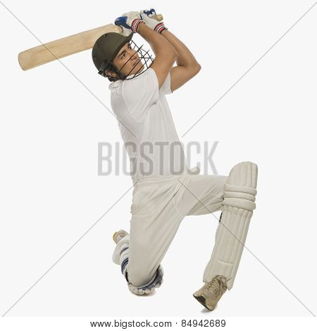 Cricket batsman playing a cover drive