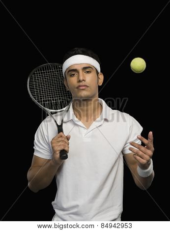 Tennis player with a tennis racket and a ball