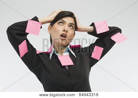 Adhesive notes on businesswoman's dress