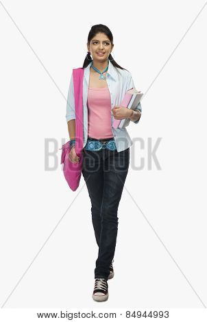 Female university student holding books
