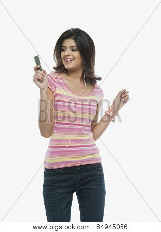 Woman listening to an mp3 player and dancing