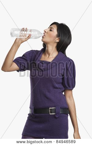Woman drinking water with a bottle