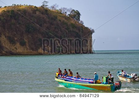 Unidentified young boys resting in an inflatable banana boat, Sua, Esmeraldas.