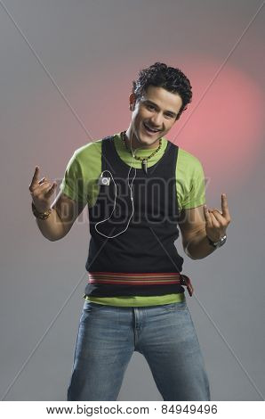Man listening to music and gesturing