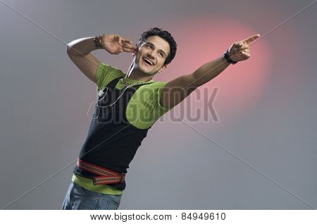 Man listening to music and pointing
