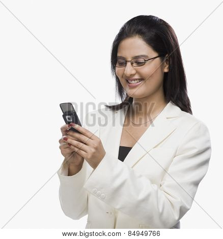 Businesswoman writing message on mobile phone