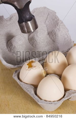Close-up of hammer over eggs