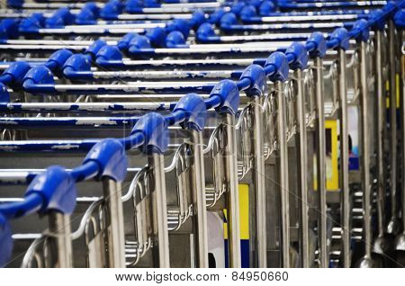 Row of luggage carts in airport