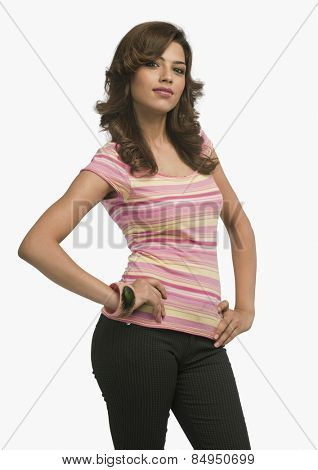 Fashion model standing with arms akimbo