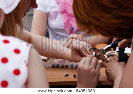 Closeup Of Women Crafting Together