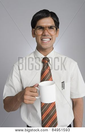 Man frowning over a coffee cup
