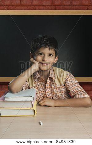 Boy imitating a teacher in a classroom