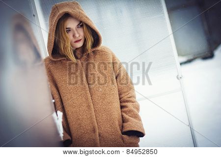 The Girl In The Coat In The Greenhouse