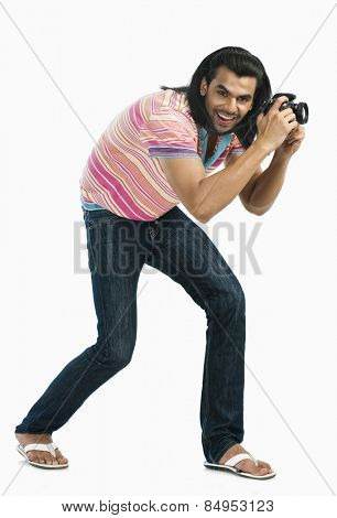 Photographer taking a picture with a digital camera