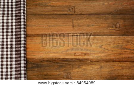 Brown Checkered Tablecloth Textile On  Old Wooden Background