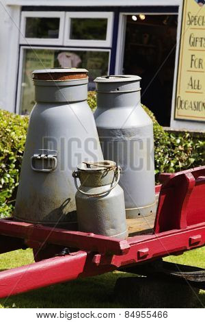Milk canisters in front of a store, Adare, County Limerick, Republic of Ireland