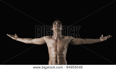 Bare chested man standing with arms outstretched