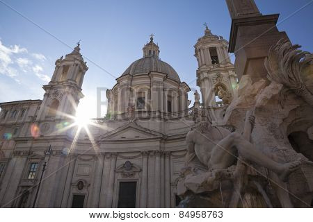 Fountain of the four Rivers with obelisk, church of SantAgnese in Agone, Piazza Navona, Rome, Italy