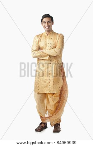 Bengali man standing with his arms crossed and smiling