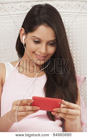 Woman listening to music on a mp3 player