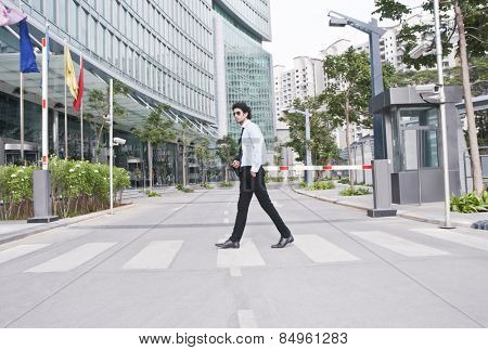 Businessman crossing the road