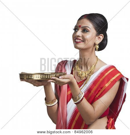 Traditional Bengali woman holding pooja thali