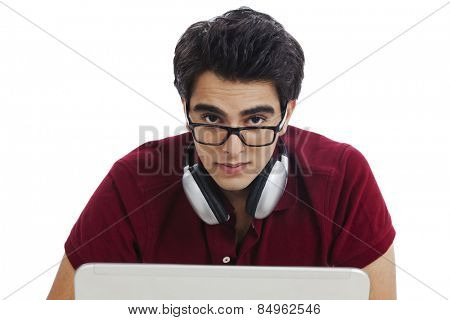 Man listening to music with headphones on a laptop