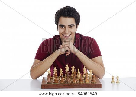 Portrait of a happy man playing chess