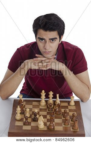 Portrait of a man playing chess and thinking