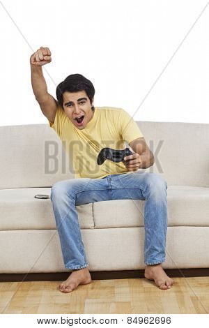 Man playing a video game and looking excited