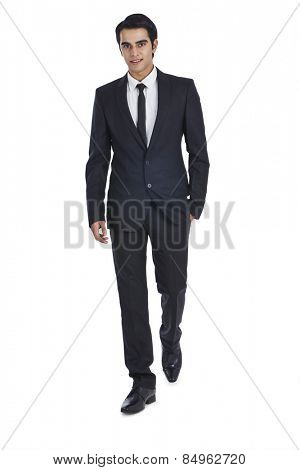 Portrait of a businessman with his hands in pockets