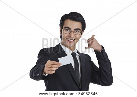 Businessman showing a blank business card and gesturing call me