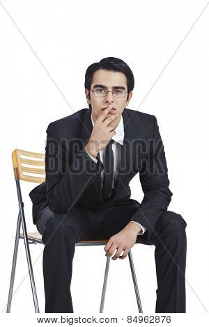 Businessman sitting on a chair and thinking
