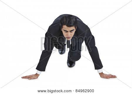 Businessman getting ready for sprint