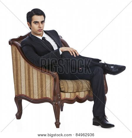 Portrait of a businessman sitting in an armchair