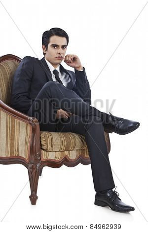 Businessman sitting in an armchair and thinking