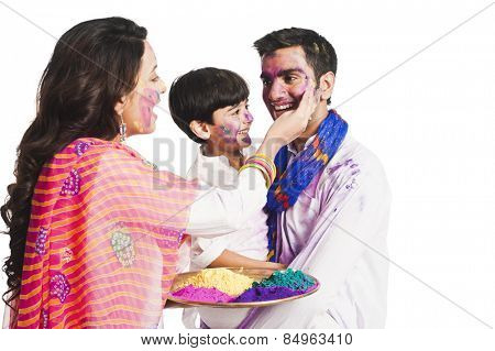 Family celebrating Holi festival