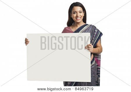 Woman holding at a whiteboard and smiling