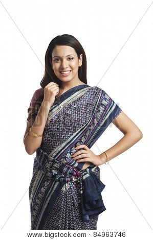Happy woman standing with her hand on hip