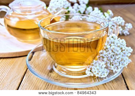 Tea with yarrow in cup on board