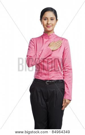 Portrait of a businesswoman with his hand on heart