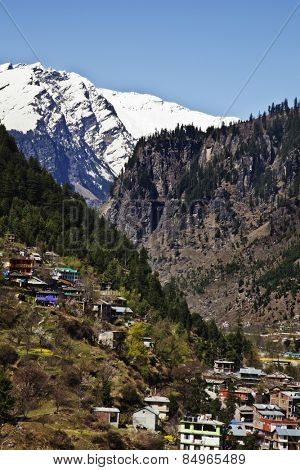 Town with snow covered mountains in the background, Manali, Himachal Pradesh, India