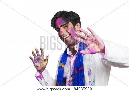 Portrait of a man celebrating Holi