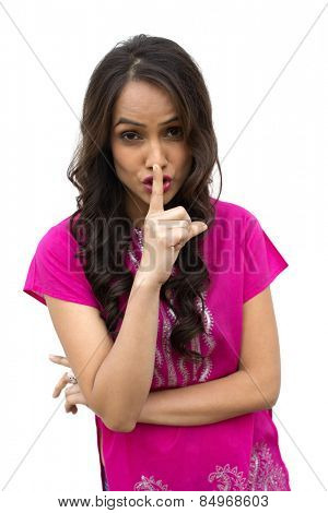 Portrait of a woman with her finger on her lips