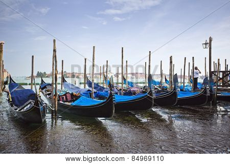 Gondolas moored at dock, Venice, Veneto, Italy