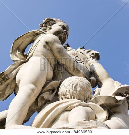 Low angle view of a statue, La Fontana Dei Putti Statue, Piazza dei Miracoli, Pisa, Tuscany, Italy